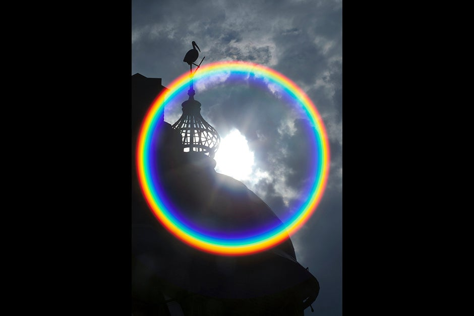 Photographer Kris Snibbe's lens flare creates a rainbow circle above the Lampoon Building at Harvard. Kris Snibbe/Harvard Staff Photographer
