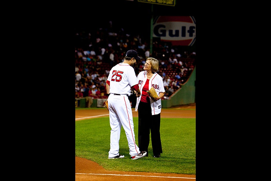 Red Sox first baseman Mike Lowell caught President Drew Faust's pitch, where afterward they met for the first time. Rose Lincoln/Harvard Staff Photographer