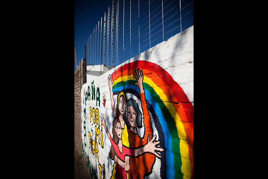 A colorful EPES mural against domestic violence is painted outside a public primary health clinic called Santa Laura in Santiago. Stephanie Mitchell/Harvard Staff Photographer