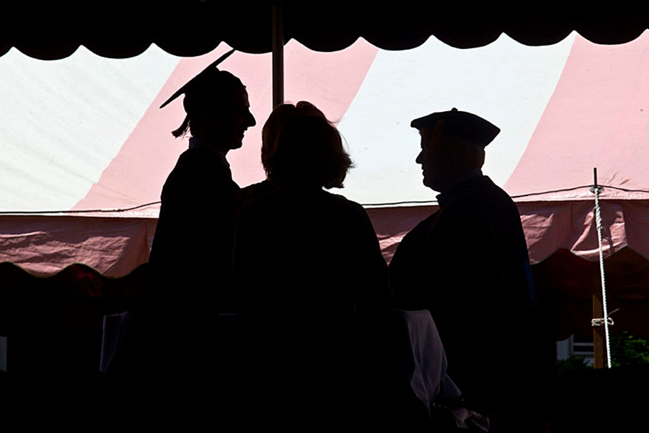 Quincy House co-master Lee Gehrke (right) awards diplomas to undergraduates. Kris Snibbe/Harvard Staff Photographer