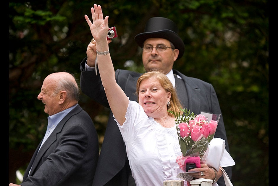 Marylynn Antonellis (center) tries desperately to attract the attention of her daughter Annie '09 outside Memorial Church, as husband Joe attempts a photo from behind his wife's outstretched hand. Jon Chase/Harvard Staff Photographer