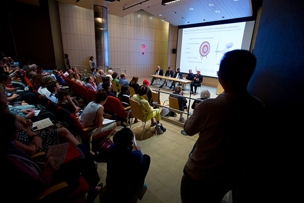 """""""The Road to Vital Therapy,"""" part of the Broad Institute's midsummer science lecture series, revealed how researchers tap the human genome in their efforts to fight disease. Yet genomic information isn't a magic elixir, warned panelist James E. Bradner."""