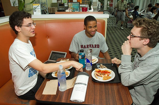 Summer School students Sdelios Rousoglou (from left), of Athens College in Greece, Zavonte Stephens, a high school student from Detroit, and Axel Ericsson from Stockholm, Sweden, enjoy a lunch together in the Science Center.