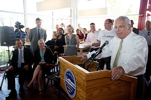 """Small businesses are the backbone of the city and a key to what makes Boston's neighborhoods work,"" said Mayor Thomas M. Menino (at podium) during the ribbon-cutting ceremony at Swissbäkers in Allston."