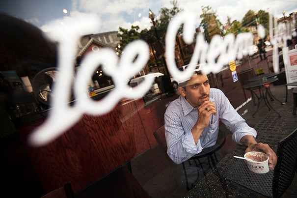 """Ali Almossawi, a former HBS research associate, was back in town on business when he stopped by J.P. Licks — for the second time. Almossawi admitted that there might be a couple of more returns before he headed back to the West Coast on Monday. """"I miss it,"""" he said of the local flavor. Jeremy Watson (third photo) of Harvard's Bauer Laboratory seemed to support the belief that cooler temps do not interfere with the pleasures of the chilly treat."""