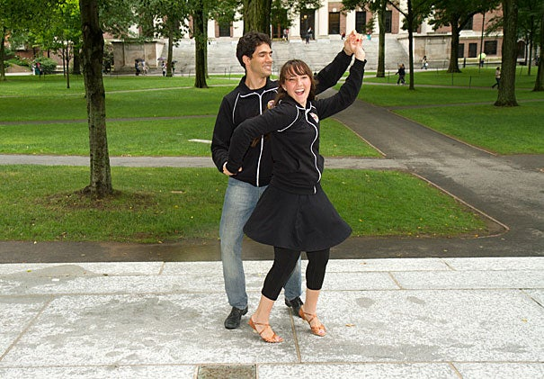 "Harvard Ballroom dance instructors Drago Guggiana-Nilo and Cristina Foyo Cardenas perform some dance moves from their beginning salsa class on the steps of Memorial Church. ""Dancing has helped me to be more confident,"" said Foyo Cardenas."