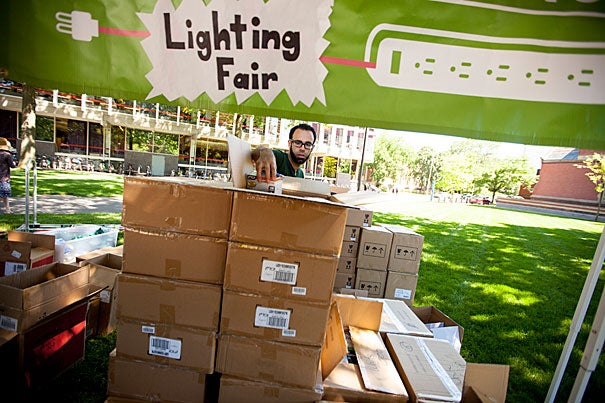 At Tuesday's Lighting Fair, faculty, students, and staffers like Research Associate in Computer Science Randy Pollack (photo 2) chose from a variety energy-saving devices, chalking up discounts of about 90 percent.