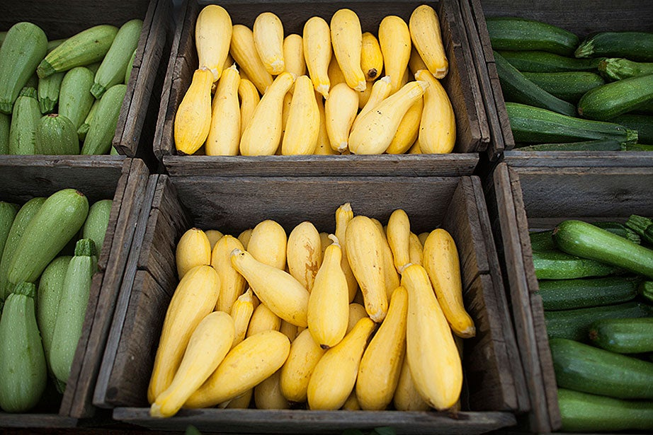 Summer squash and zucchini stand proud at the Farmers' Market. Packed with vitamin C and potassium, they pair well in a summer stir-fry.