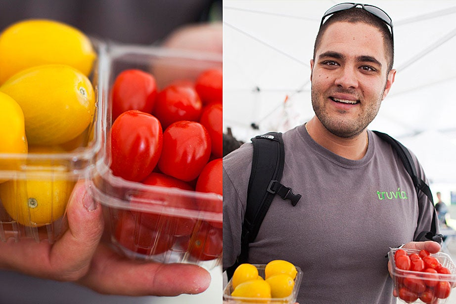 "Edan Razinovsky was excited to use these cherry and yellow heirloom tomatoes in a salad with olive oil and garlic. ""I'm also going to get some zucchini and squash, scoop out the insides, and stuff them with chicken. It's a Middle Eastern dish. My family is Israeli, my parents have been making this forever."""