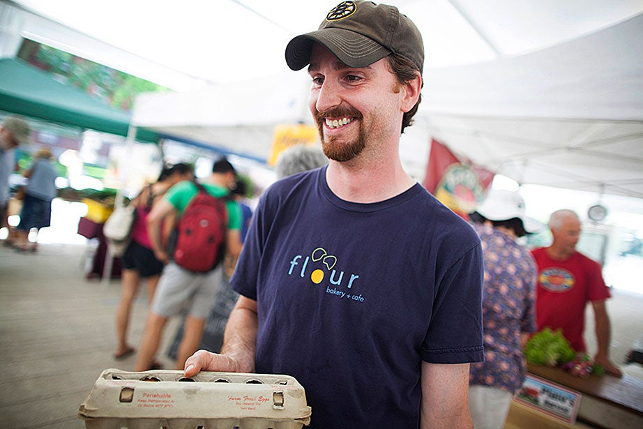 """Jed Washburn had big plans for his Farmers' Market foray: """"We're making Andalusian gazpacho … also, fish en papillote, so I have some leeks for that … Also some ground pork for homemade Asian sausages."""" He loves to cook, he confessed, adding, """"My fiancée is the head production baker at Flour Bakery."""""""
