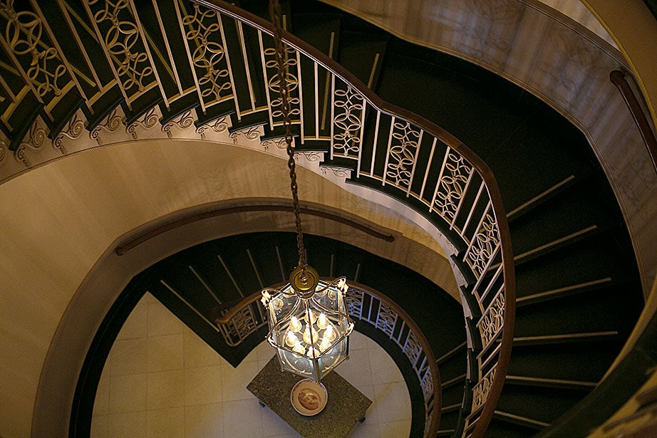 The main staircase spirals through the space.