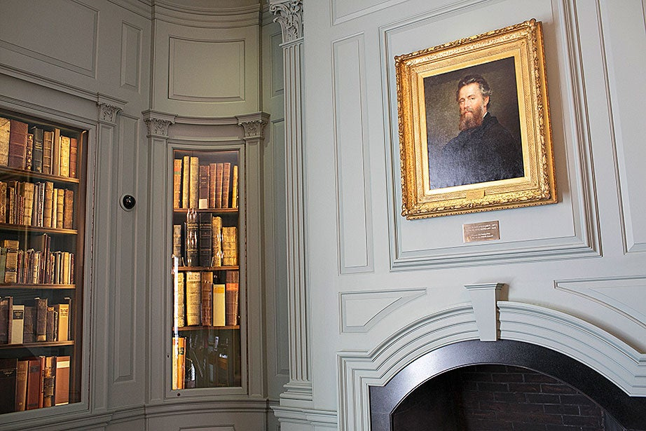 A portrait of Herman Melville by Joseph Oriel Eaton decorates the Edison and Newman Room.