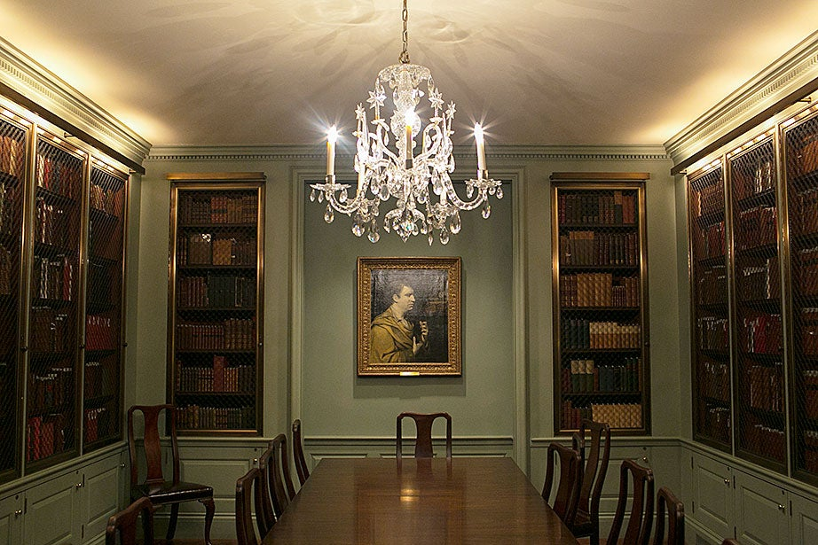In the Green Room, a portrait of Samuel Johnson by Sir Joshua Reynolds is illuminated by a chandelier.