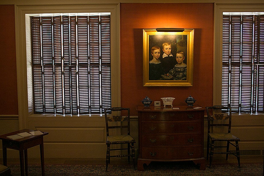 Furniture from the Dickinson homestead and a portrait of the family's children by Otis A. Bullard are on display in the Dickinson Room.