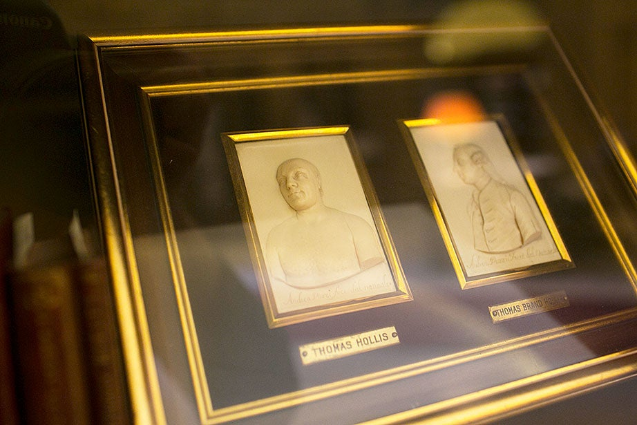 In the lobby, relief likenesses of Thomas Hollis and Thomas Brand Hollis are on display.