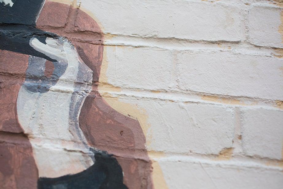 Charlie Chaplin tips his hat from a mural along Church Street.