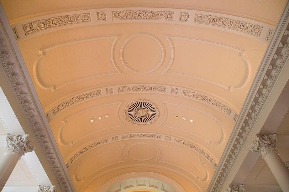 A warm, soft light illuminates the ceiling of Memorial Church.