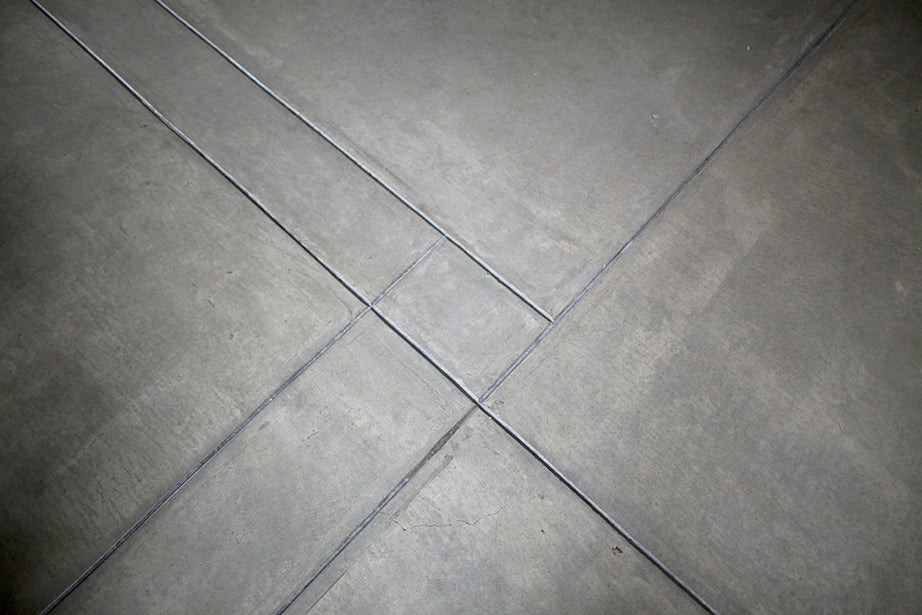 Floors constructed of concrete, as seen in the Sert Gallery lobby, are featured throughout the Carpenter Center.