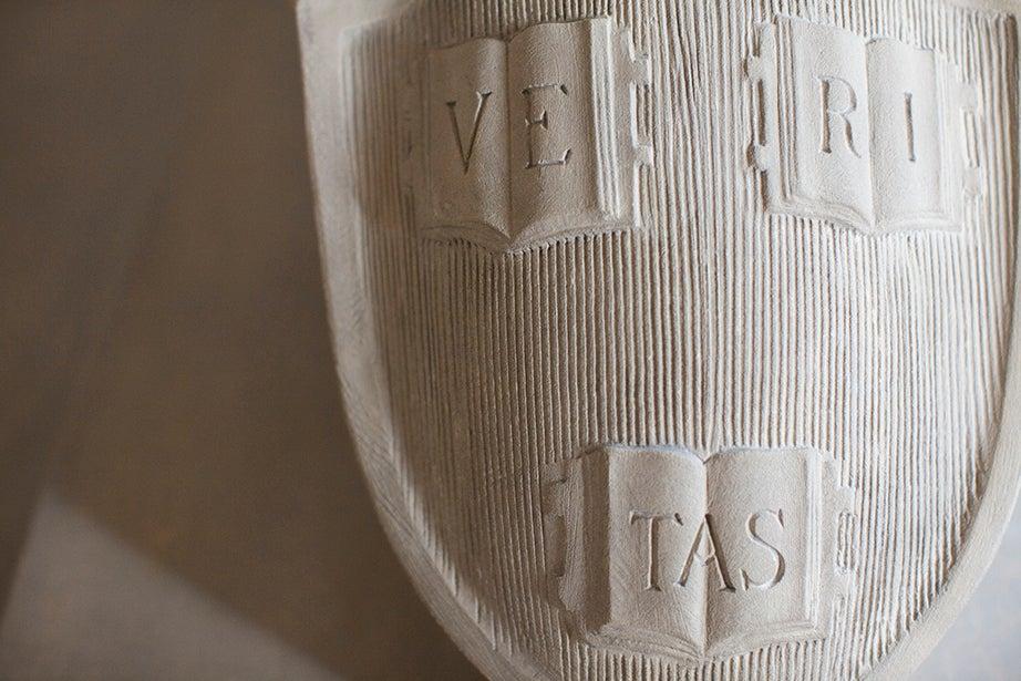 "The Veritas shield adorns the fallen soldier in the Memorial Church sculpture titled ""The Sacrifice."""