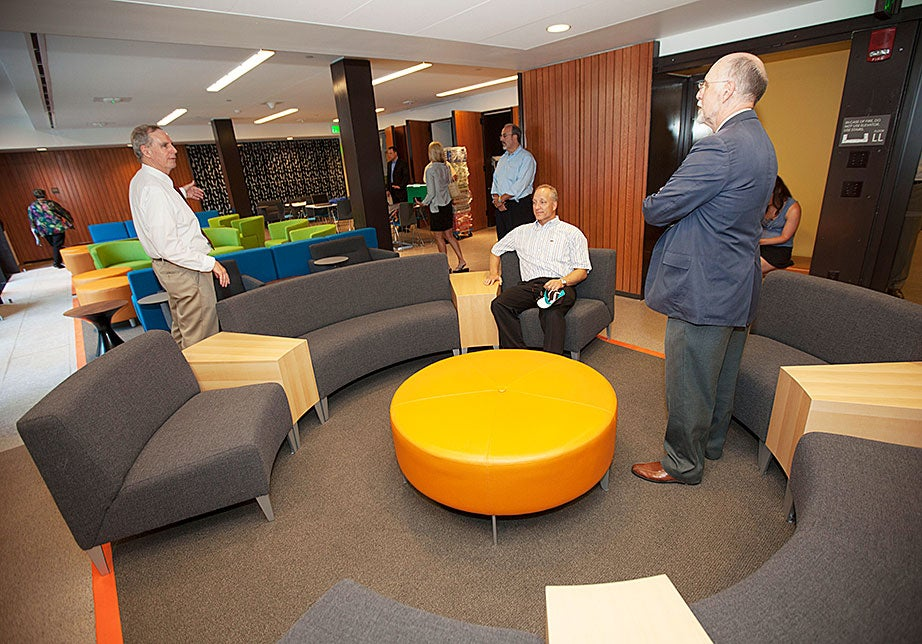 Faculty of Arts and Sciences Dean Michael D. Smith (center, seated) and interim Dean of Harvard College Donald Pfister (right, standing) are pictured in the new lower-level multipurpose room.