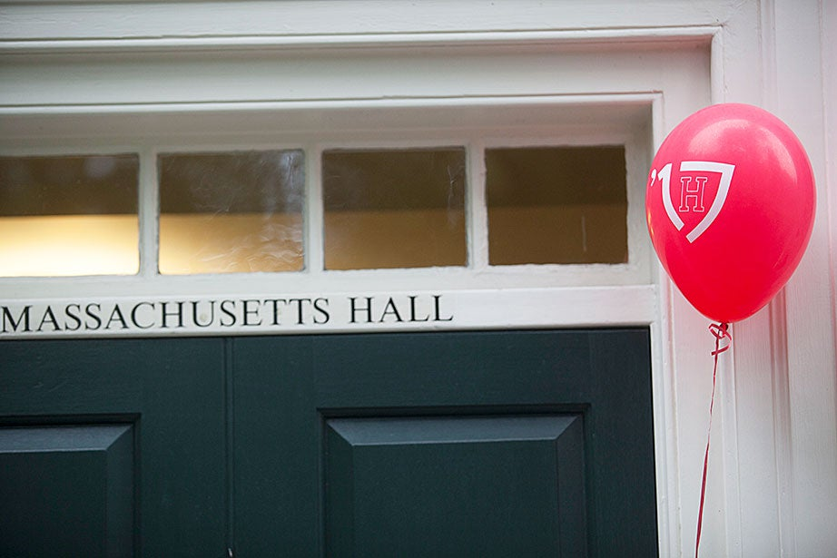 A Class of '17 balloon floats outside Massachusetts Hall, Harvard's oldest dorm, which also houses Harvard's president and provost.