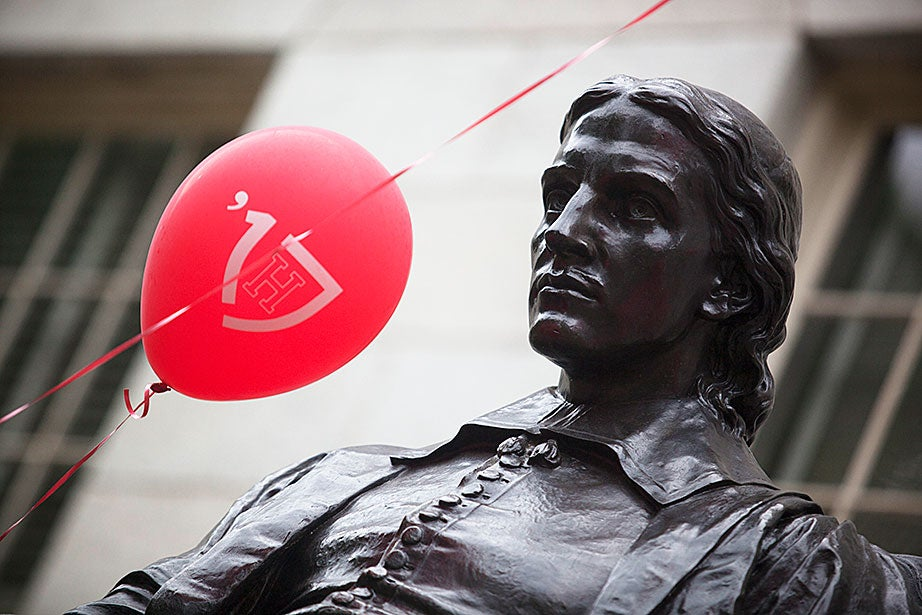 Harvard College Class of '17 balloons decorate the John Harvard Statue as freshmen move into Harvard Yard.