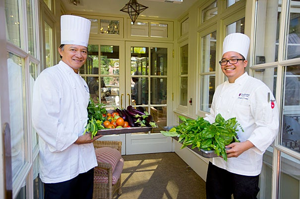 """""""We're really growing a lot in this little space that we have,"""" said Harvard Faculty Club banquet chef Joseph Santos (right), with the club's executive chef Rolando Abaquin."""