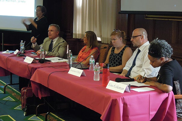 """""""Working with People with Disabilities: What Happens After You Say Hello?"""" was the topic of a discussion that included panelists Kevin G. McGuire (seated from left), Michele Clopper, Stefanie Farrell, Jonathan G. O'Dell, and panel moderator Lisa M. Coleman, Harvard's chief diversity officer. The interpreter (far left) was Jody Steiner, Harvard coordinator of services for the deaf and/or hard of hearing."""