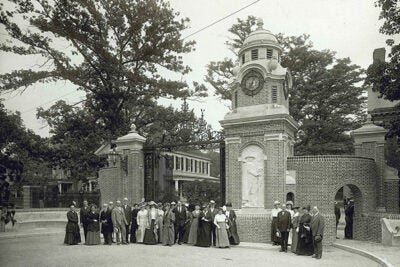 The short-lived and quirky Dudley Gate was dedicated in 1915, as seen in this photo. It was demolished in 1947 to make way for the Lamont Library gates.