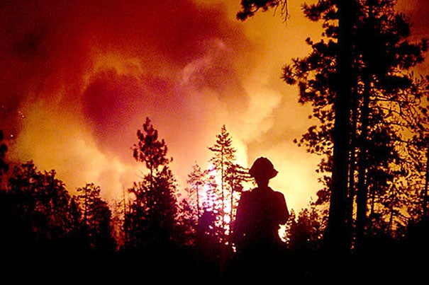 """When you get a large temperature increase over time, as we are seeing, and little change in rainfall, fires will increase in size,"" said researcher Loretta J. Mickley. A graphic depicts the projected increase of fires in the western United States by 2050 (courtesy of Xu Yue). Firefighters are currently battling dozens of fires in at least 11 states."