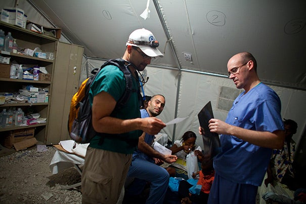 "Harvard's global presence continues to expand. In 2010, volunteers assisted in Haiti following the earthquake there (photo 1). In 2013, students and professors worked with scholars at the David Rockefeller Center's office in São Paulo, Brazil (photo 2). Researching India's Kumbh Mela and the ""ephemeral city"" was the focus across Harvard's Schools in early 2013 (photo 3)."