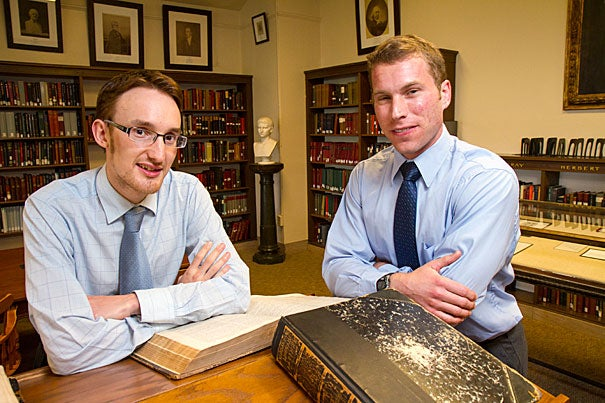 """Last year, Ph.D. student Stuart M. McManus (left) discovered a poem by Benjamin Larnell, the last Native American student at Harvard in the colonial era. Larnell's poem is most interesting for what it signifies, said Tom Keeline, a scholar of Latin pedagogy: """"that American Indians were trained in exactly the same way as colonial Puritans."""""""
