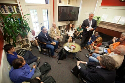 Center for Middle Eastern Studies Director William Granara introduces Harvard Kennedy School Professor Tarek Masoud (sitting, from left), A.J. Meyer Professor of Middle East History Emeritus Roger Owen, and graduate student Sarah Moawad, who discussed Egypt's political turmoil.