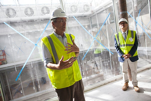 """""""My message is this is going to be a very different kind of art museum,"""" said Harvard Art Museums director Thomas W. Lentz (left), who led a tour with Charles Klee, the principal at the architectural firm Payette, which is collaborating with the Renzo Piano Building Workshop on the renovation and expansion project (photo 1). Among the features in Renzo Piano's design is a glass rooftop, a giant skylight that will diffuse light down through the building's new central circulation corridor, adjacent galleries, and onto the Calderwood Courtyard (photo 2). The exterior is a combination of both the modern and traditional (photo 3)."""