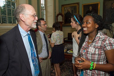 Harvard College interim Dean Donald Pfister spoke with Harriet Kariuki '16 (photo 1), while others congregated after meeting the deans at University Hall (photo 2). Giora Ashkenazi '17 (left) had questions for Dean of Student Life Stephen Lassonde (photo 3).