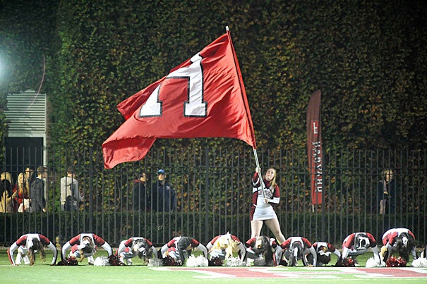 """More than 17,000 fans came out on a beautiful fall night to watch Harvard's first home game for the season on Sept. 28 (photo 1). And despite the win, head football coach Tim Murphy (photo 2) remained cautious: """"We are off to a solid start at 2-0, but we have a great deal of room for improvement, and we are focused on … our next game [Holy Cross]."""" Paul Stanton Jr. '16 made a touchdown run during the Brown game (photo 3)."""