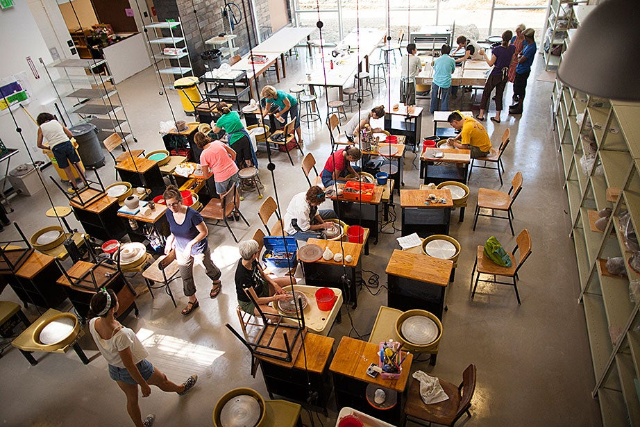 The Ceramics Program opens a new facility at 224 Western Ave. in Allston that includes a public gallery and other enhanced spaces and amenities. The large wheel throwing space is pictured from above during a wheel throwing class with porcelain clay.