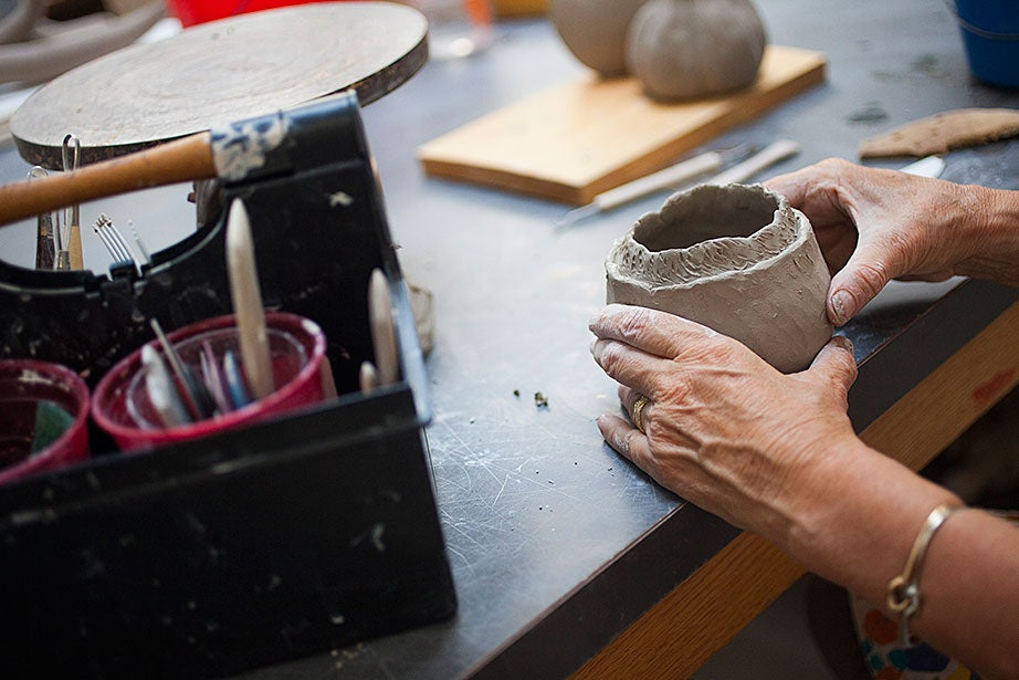 Emma Vesey decorates the surface of her hand-built pot.