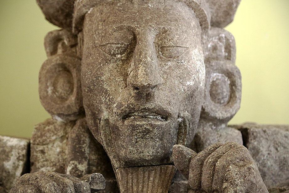 A sculpture of the head of the Maya ruler 12, K'ahk' Uit' Ha' K'awiil, recovered at Rastrojón in the Copán Valley, Honduras. Researchers believe the site was a residential palace and military outpost.