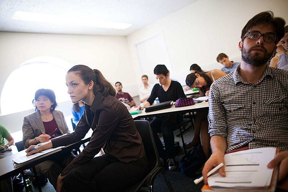 Cassandra Peitzman (left) and Gabriel Tourek listen to Raj Chetty's lecture. Stephanie Mitchell/Harvard Staff Photographer