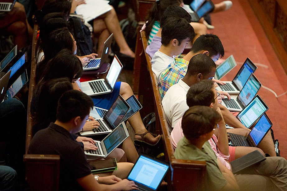Students take notes on laptops during Michael Puett's talk. Rose Lincoln/Harvard Staff Photographer