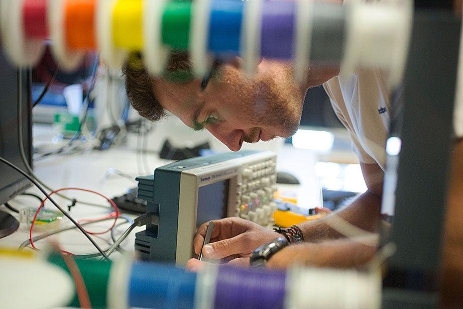 Slava Arabagi works on soft sensor fabrication at the Harvard Microrobotics Laboratory.