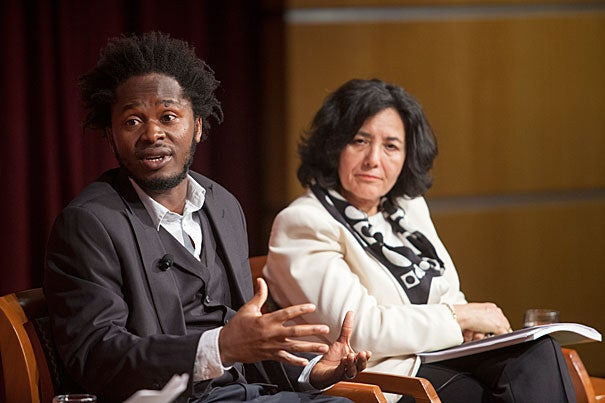 """Ishmael Beah, a former child soldier in Sierra Leone and the author of """"A Long Way Home: Memoirs of a Boy Soldier"""" spoke with Leila Zerrougui (right), the U.N.'s special representative of the secretary-general for children and armed conflict at the Harvard Kennedy School's JFK Jr. Forum on Monday."""