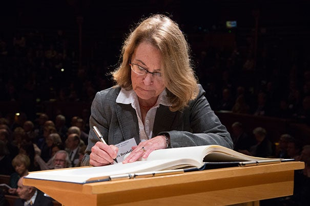 Xandra Owens Breakefield, a professor of neurology at Harvard Medical School, signs the American Academy of Arts and Sciences' Book of Members, a tradition that dates back to 1780.