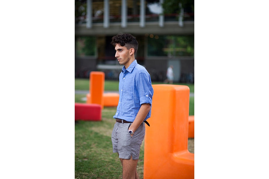 """It only took Evan Grandfield '17 a few minutes to get dressed — classic button-down, rolled to the elbows, and a surprising pair of shorts. """"My style is prepster,"""" he said."""