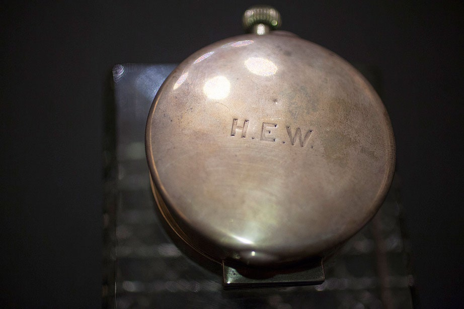 "The hinged lid of a pocket watch, inscribed ""H.E.W.,"" part of a crystal inkwell owned by Harry Elkins Widener. (MS HEW 5, Houghton Library, Harvard University)"
