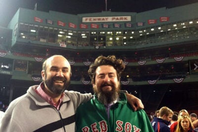 Red Sox organist Josh Kantor (left) after the Sox won the series at Fenway Park.