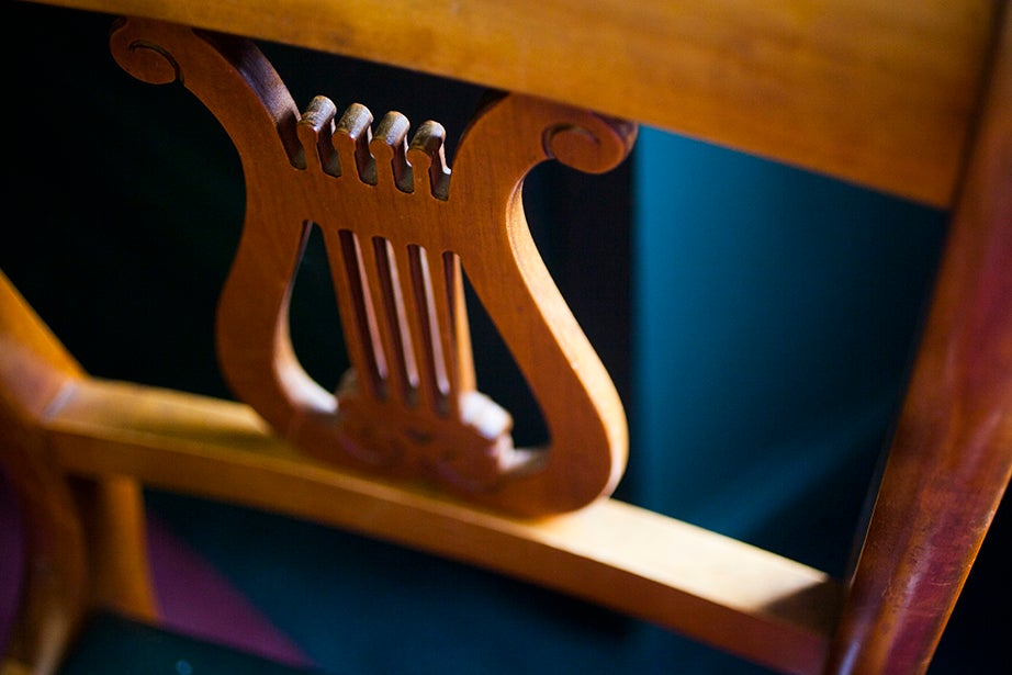 A carved lyre decorates the chairs inside the Loeb Music Library.