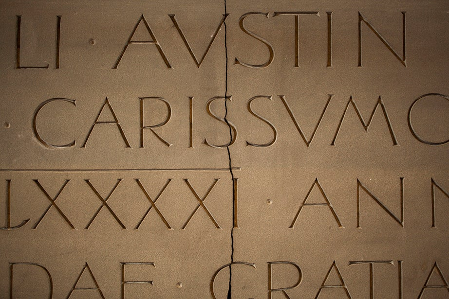 Engravings adorn the grand fireplace inside the Ames Courtroom of Austin Hall at Harvard Law School.