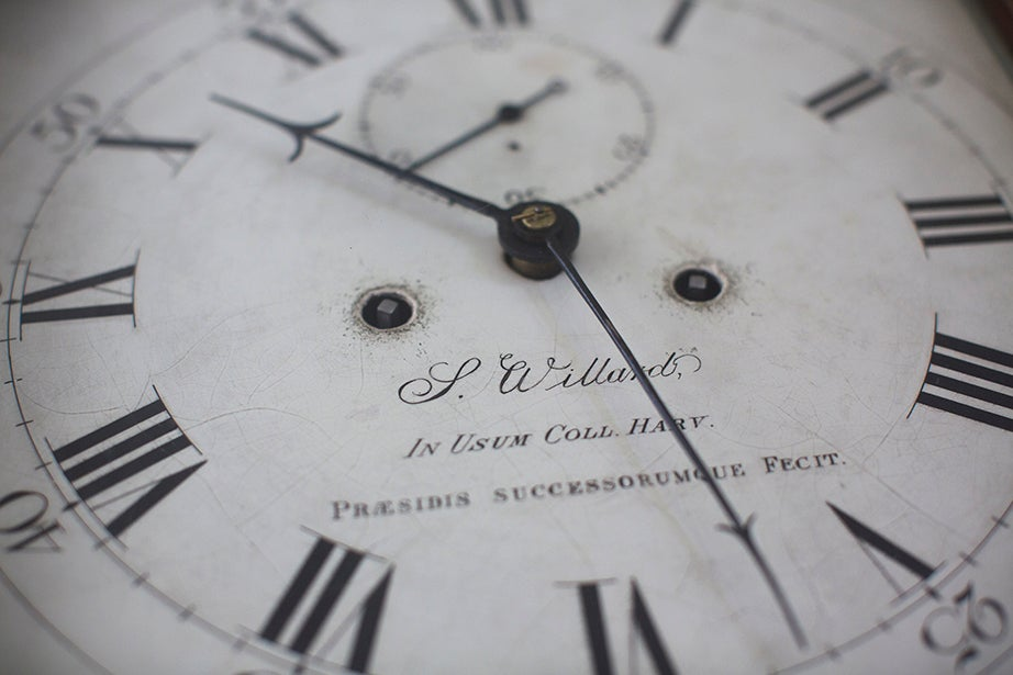 The face of an 1872 eight-day tall-case clock is displayed in the Faculty Room of University Hall.